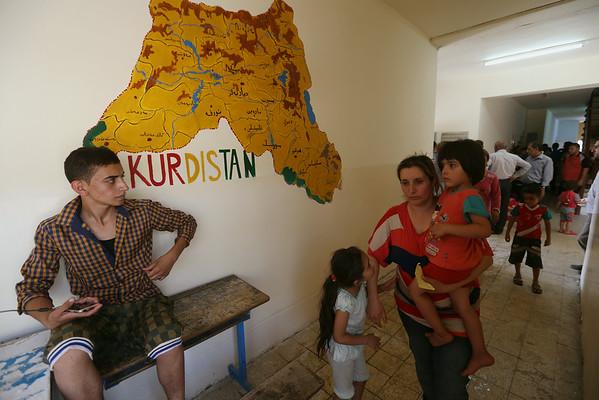 PHOTOS: Iraqi Christians take shelter in Kurdistan, fleeing extremists