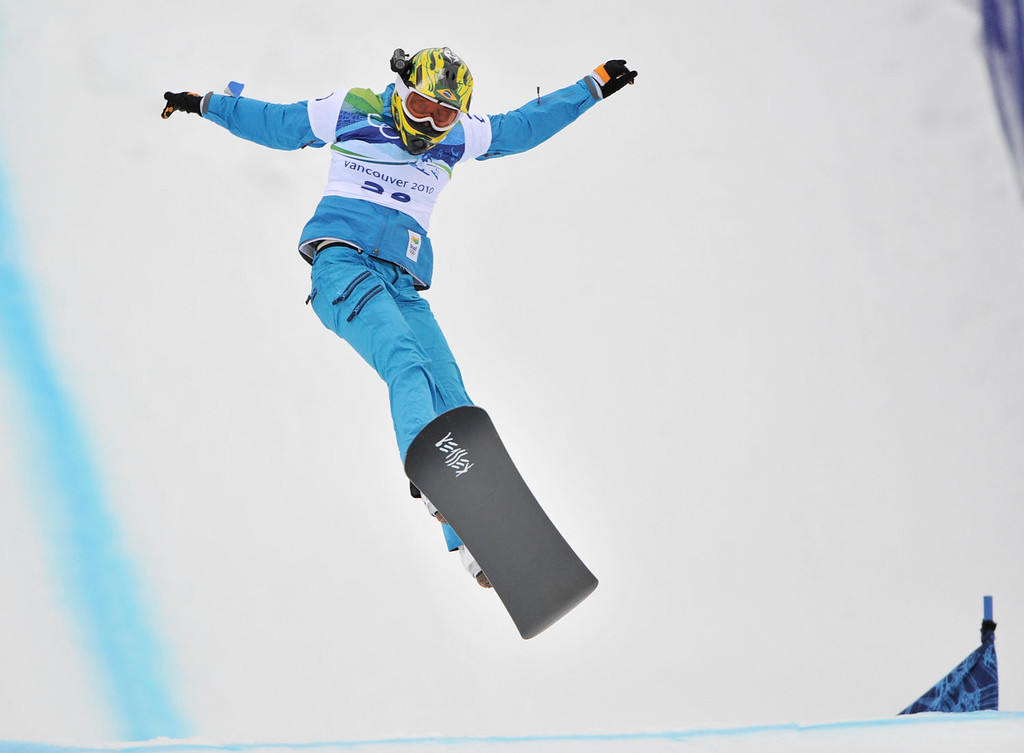 . Isabel Clark Ribeiro of Brazil during the ladies snowboardcross qualifiers at the Vancouver 2010 Olympics in Vancouver, British Columbia, Tuesday, Feb. 16, 2010. (AP Photo/Bela Szandelszky)