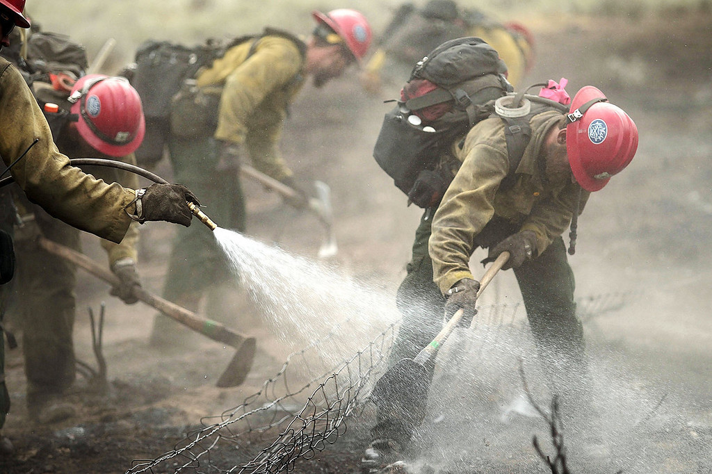 . Members of the Prescott Hotshots mop up part of the Beaver Creek Fire on Saturday, Aug. 17, 2013 west of Hailey, Idaho.(AP Photo/Times-News, Ashley Smith) Mandatory Credit