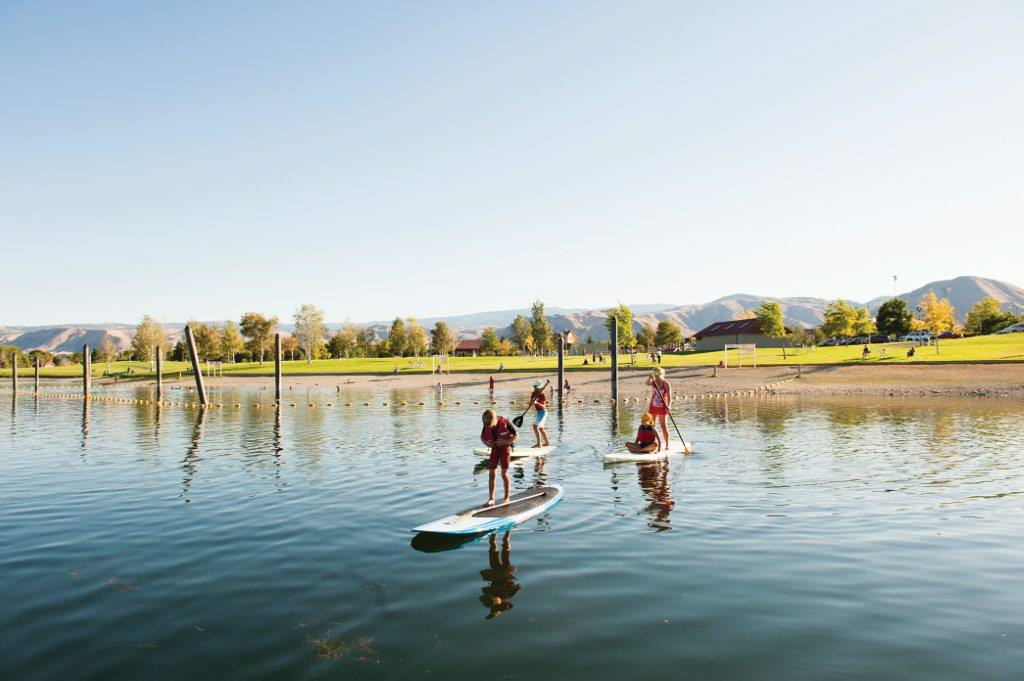 . Stand-up paddle boarding on the Columbia River in Wenatchee, Washington. (Photo by Icicle TV, provided by Wenatchee Valley Chamber of Commerce)