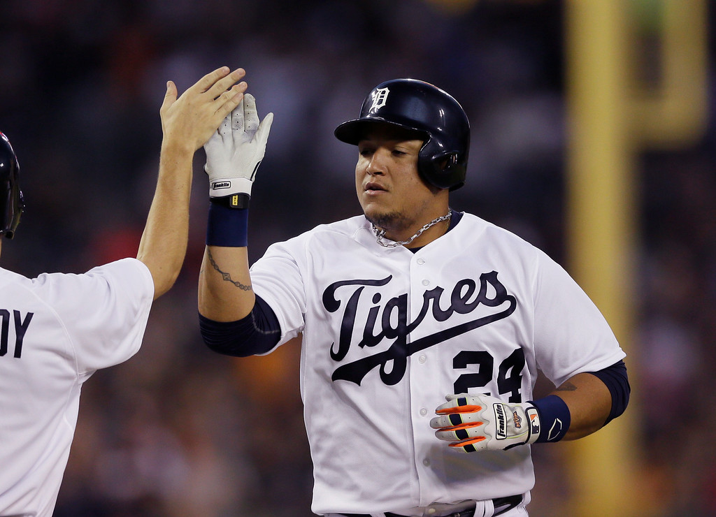 . Detroit Tigers\' Miguel Cabrera rounds the bases after his solo home run during the third inning of an interleague baseball game against the Colorado Rockies, Saturday, Aug. 2, 2014, in Detroit. (AP Photo/Carlos Osorio)