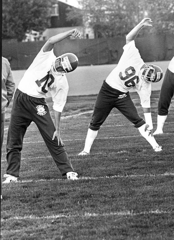. May 5, 1981: Broncos quarterback Mark Herrmann, right, and tight end Clay Brown could have given Jane Fonda a run for her money. (John Prieto, The Denver Post)