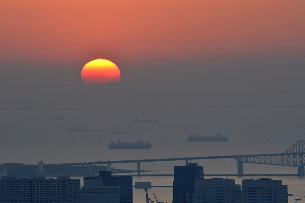 . The sun rises on New Year\'s Day over Tokyo Bay on January 1, 2014. Some 200 people saw the first sunrise of Tokyo in 2014 from the Roppongi Hills observation deck, 270 metres (885 ft.) above sea level.     AFP PHOTO/ KAZUHIRO NOGIKAZUHIRO NOGI/AFP/Getty Images