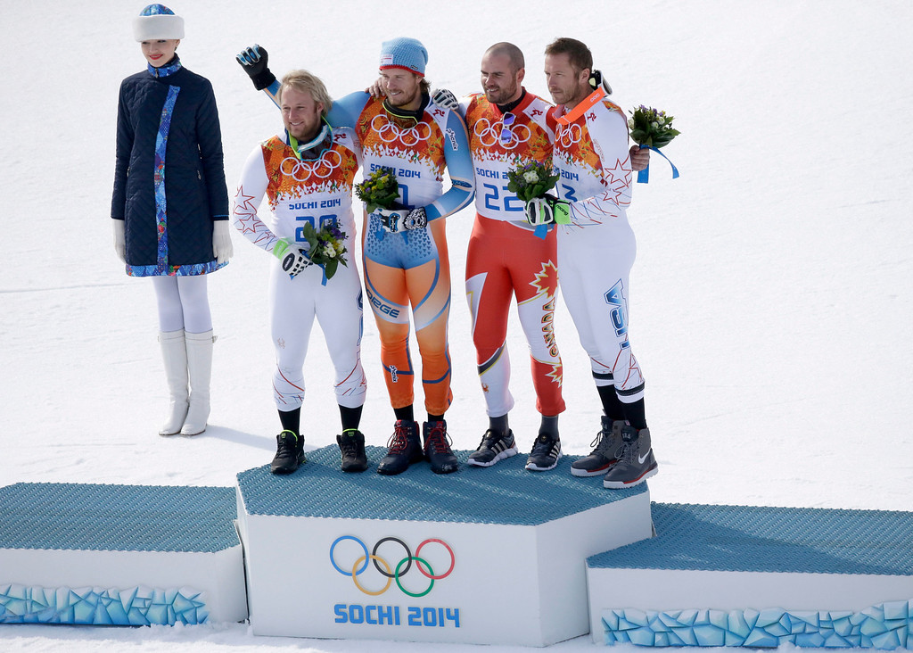 . Men\'s super-G medalists from left, United States\' Andrew Weibrecht (silver), Norway\'s Kjetil Jansrud (gold), Canada\'s Jan Hudec (bronze) and United States\' Bode Miller (bronze) pose for photographers on the podium for a flower ceremony at the Sochi 2014 Winter Olympics, Sunday, Feb. 16, 2014, in Krasnaya Polyana, Russia.(AP Photo/Lee Jin-man)