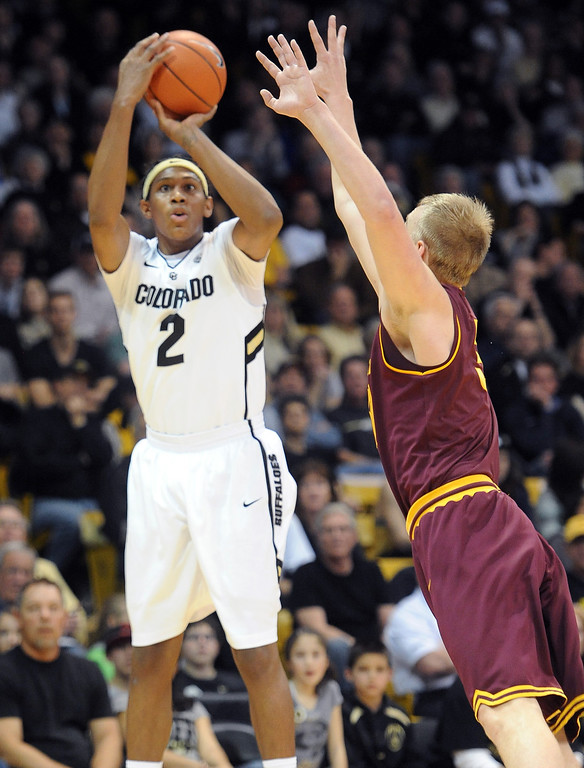 . Xavier Johnson of CU fire up a three against Arizona State during the first half of the February 16th, 2013 game in Boulder. Cliff Grassmick / February 16, 2013