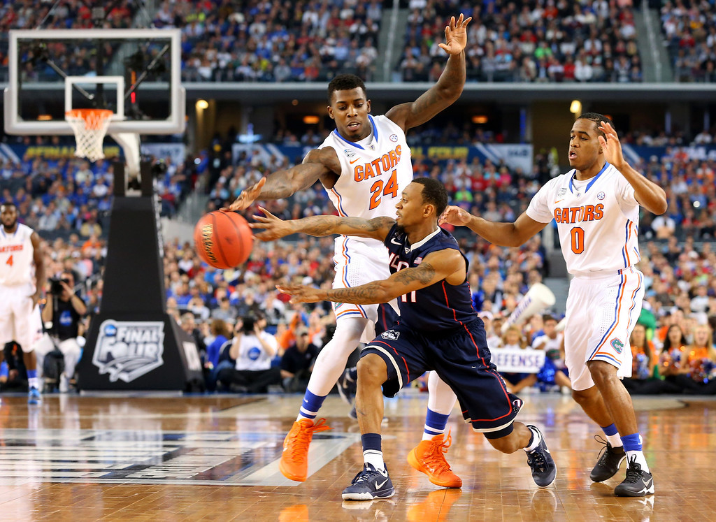 . ARLINGTON, TX - APRIL 05: Ryan Boatright #11 of the Connecticut Huskies passes as Casey Prather #24 of the Florida Gators defends during the NCAA Men\'s Final Four Semifinal at AT&T Stadium on April 5, 2014 in Arlington, Texas.  (Photo by Ronald Martinez/Getty Images)