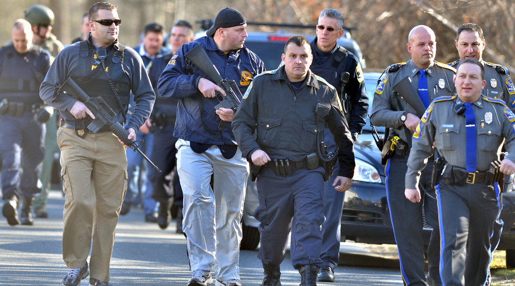 . Outside the firehouse near the Sandy Hook School in Newtown, shooting aftermath.  Melanie Stenge/New Haven Register  12/14/12