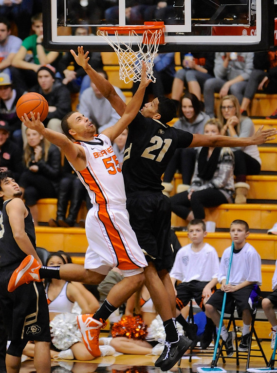 . Colorado\'s Andre Robeson (21) defends a shot by Oregon State\'s Roberto Nelson (55) during the first half of an NCAA college basketball game in Corvallis, Ore., Sunday, Feb. 10, 2013. (AP Photo/Greg Wahl-Stephens)