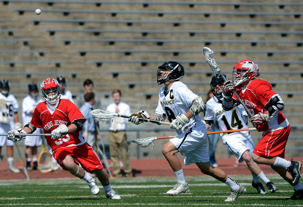 . LITTLETON, CO. - MAY 04:  Regis Jesuit\'s Brian Wegner and Arapahoe\'s Ben Eigner chase a ball during the varsity high school lacrosse game between the Arapahoe Warriors and the Regis Jesuit Raiders in Littleton, CO May 04, 2013. The Raiders won the game 9-6.  (Photo By Craig F. Walker/The Denver Post)