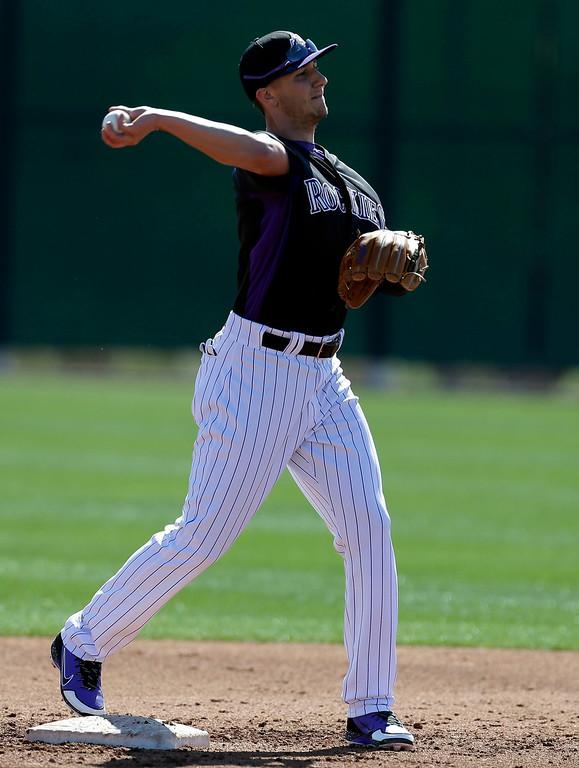 . Colorado Rockies\' Troy Tulowitzki throws to first base during a spring training baseball workout on Sunday, Feb. 17, 2013, in Scottsdale, Ariz. (AP Photo/Darron Cummings)