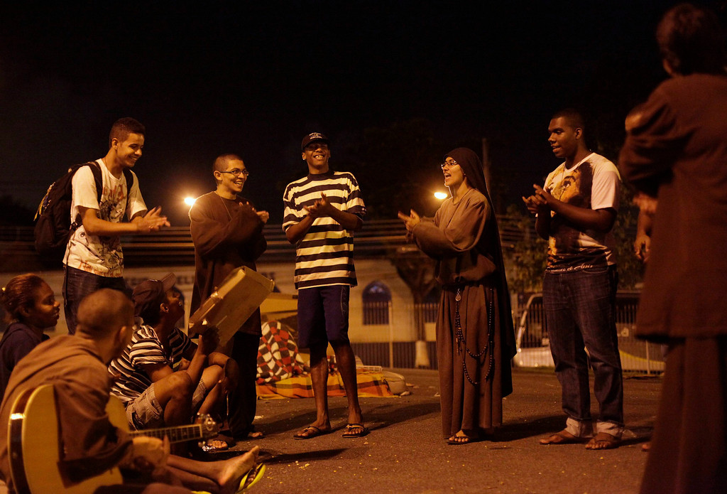 . Members of the Franciscan fraternity O Caminho, play religious music in the Campo Grande neighborhood of Rio de Janeiro April 17, 2013. O Caminho (The Way) are a group of Franciscan monks and nuns who help the homeless on the streets of Rio de Janeiro. They consider the election of Pope Francis, the first pontiff to take the name of St Francis of Assisi, to be a confirmation of their beliefs in poverty and simplicity. In July, Pope Francis will visit Rio de Janeiro in his first international trip since assuming the papacy. Picture taken April 17, 2013. REUTERS/Ricardo Moraes