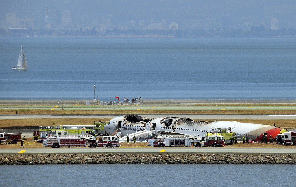 . An Asiana Airlines Boeing 777 is seen on the runway at San Francisco International Airport after crash landing on July 6, 2013. Video footage showed the jet, Flight 214 from Seoul, on its belly surrounded by firefighters.  Josh Edelson/AFP/Getty Images