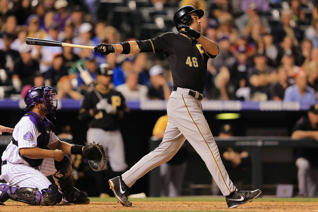 . DENVER, CO - AUGUST 10:  Garrett Jones #46 of the Pittsburgh Pirates triples to score Russell Martin #55 of the Pittsburgh Pirates and take a 2-1 lead over the Colorado Rockies in the sixth inning at Coors Field on August 10, 2013 in Denver, Colorado.  (Photo by Doug Pensinger/Getty Images)