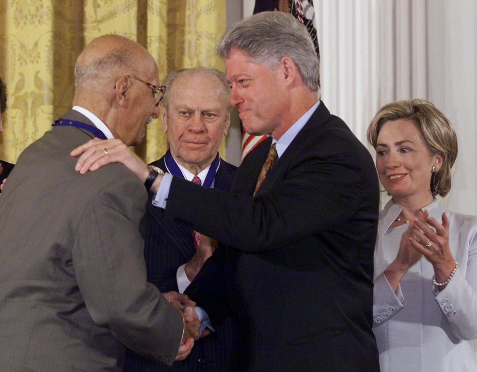 . President Clinton awards the Presidential Medal of Freedom, the nation\'s highest civilian honor, to civil rights lawyer Oliver White Hill, left, during an East Room ceremony at the White House Wednesday, Aug. 11, 1999, in Washington. Hill is best known for litigating one of the school desegregation cases that became the landmark Brown vs. Board of Education case. Former President Ford, center, and first lady Hillary Rodham Clinton, far right, add their applause. (AP Photo/J. Scott Applewhite)