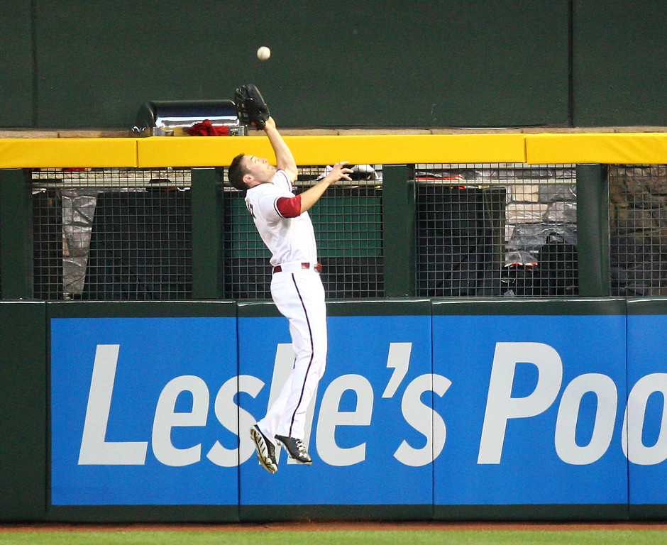 . Arizona Diamondbacks center fielder A.J. Pollock makes a diving catch during the first inning of a baseball game against the Colorado Rockies on Friday, April 26, 2013 in Phoenix. (AP Photo/The Arizona Republic, Aaron Lavinsky)  MARICOPA COUNTY OUT; MAGS OUT; NO SALES