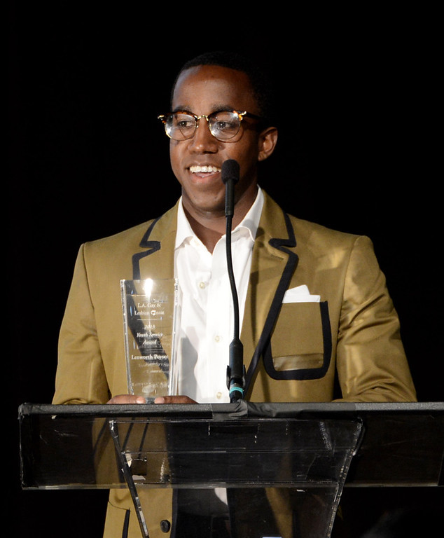 """. Honoree Lenworth Poyser speaks at \""""An Evening\"""" benifiting The Gay & Lesbian Center at the Beverly Wilshire Hotel on March 21, 2013 in Beverly Hills, California.  (Photo by Kevin Winter/Getty Images)"""