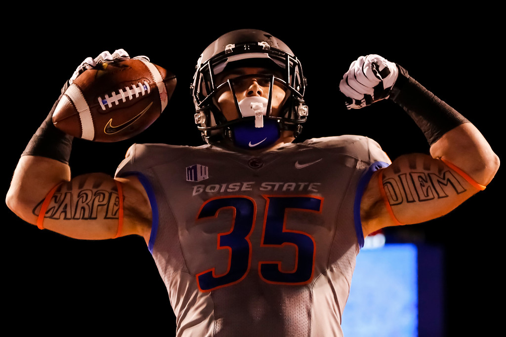 . Boise State running back Charles Bertoli (35) celebrates a touchdown against Southern Mississippi during the second half of an NCAA college football game in Boise, Idaho, Saturday, Sept. 28, 2013. Boise State won 60-7. (AP Photo/Otto Kitsinger)