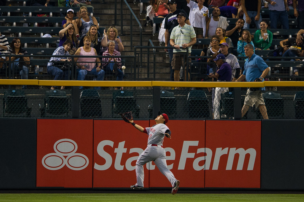 . DENVER, CO - AUGUST 30:  Shin-Soo Choo #17 of the Cincinnati Reds chases down a long fly ball for an out in the third inning of a game against the Colorado Rockies at Coors Field on August 30, 2013 in Denver, Colorado. (Photo by Dustin Bradford/Getty Images)