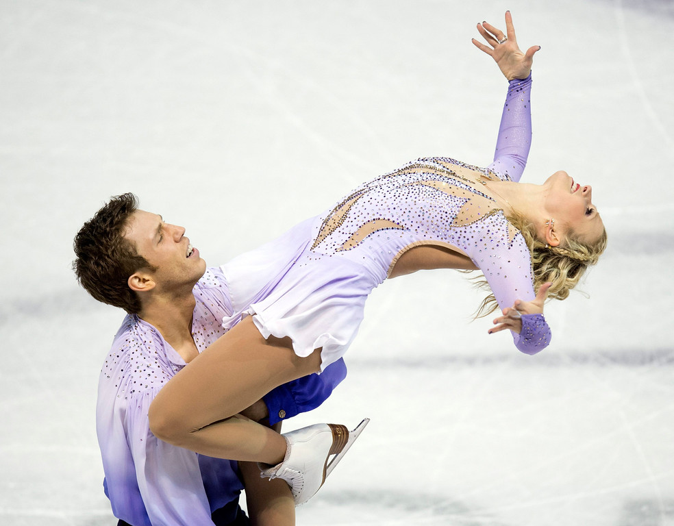 . Kirsten Moore-Towers and Dylan Moscovitch of Canada, perform their free skate program in the pairs competition at the World Figure Skating Championships Friday, March 15, 2013 in London, Ontario. (AP Photo/The Canadian Press, Frank Gunn)
