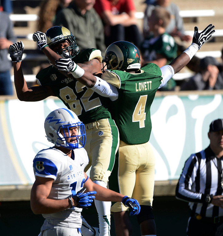 . Rashard Higgins, left, #82, Colorado State, celebrates his touchdown against Air Force in the second quarter with teammate, Charles Lovett, at Hughes Stadium  Saturday afternoon, November 30, 2013. (Photo By Andy Cross/The Denver Post)