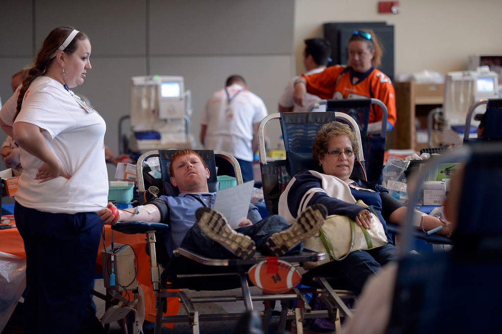 . DENVER, CO - OCTOBER 22: Blood donors lay in chairs as they attend The Denver Broncos and Bonfils Blood Center\'s 16th annual Drive for Life community blood drive October 22, 2013 at Sports Authority Field. (Photo by John Leyba/The Denver Post)