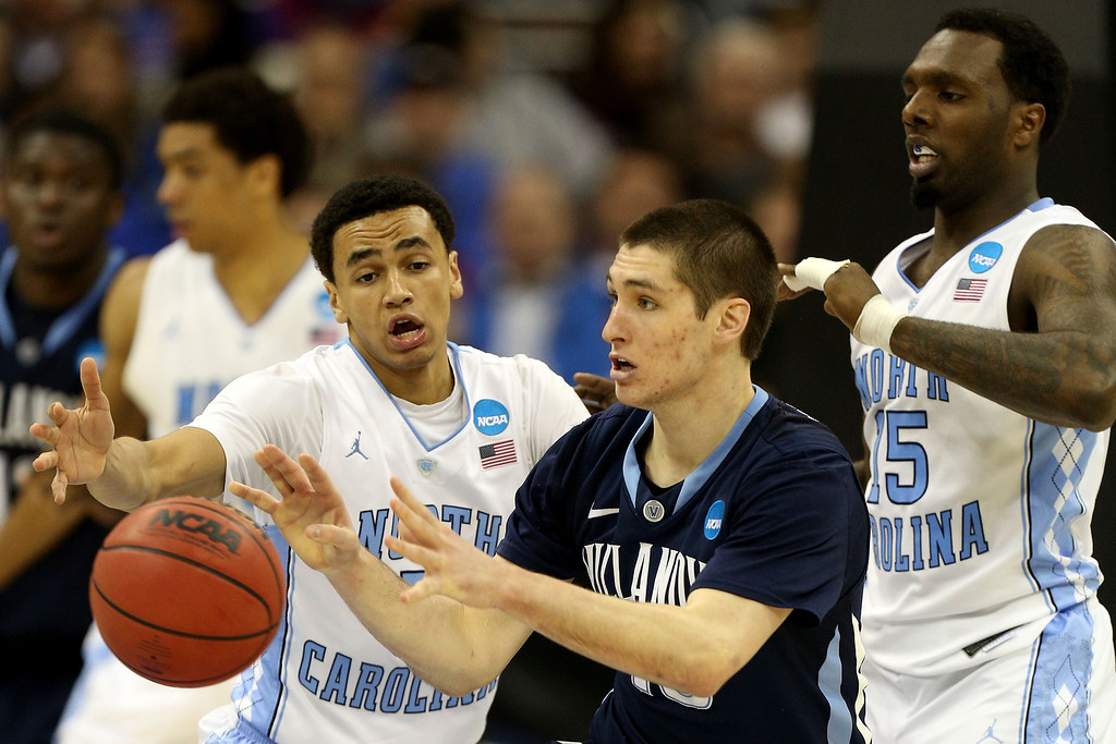 . KANSAS CITY, MO - MARCH 22: Ryan Arcidiacono #15 of the Villanova Wildcats catches a pass while defended by Marcus Paige #5 and P.J. Hairston #15 of the North Carolina Tar Heels in the second half during the second round of the 2013 NCAA Men\'s Basketball Tournament at the Sprint Center on March 22, 2013 in Kansas City, Missouri. North Carolina won 78-71.  (Photo by Ed Zurga/Getty Images)