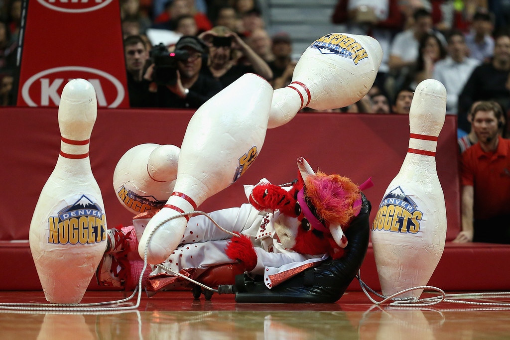 . Benny the Bull, the mascot of the Chicago Bulls, crashes into giant bowling pins during a time-out between the Bulls and the Denver Nuggets during a preseason game at the United Center on October 25, 2013 in Chicago, Illinois.  (Photo by Jonathan Daniel/Getty Images)