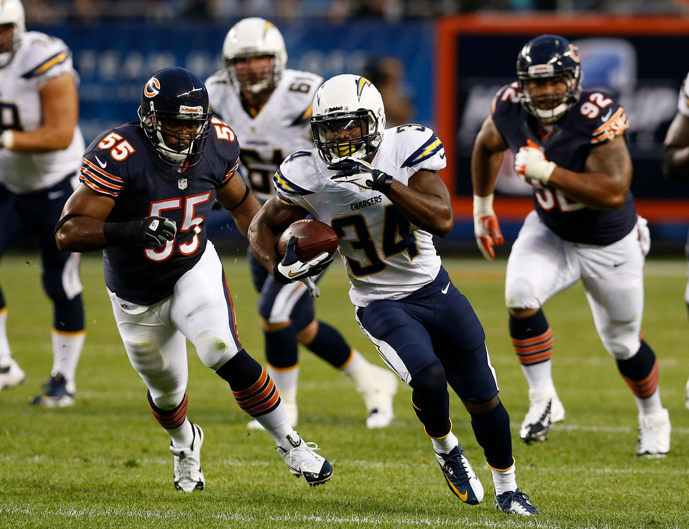 . San Diego Chargers running back Fozzy Whittaker (34) runs against Chicago Bears outside linebacker Lance Briggs (55) during the first half of the preseason NFL football game, Thursday, Aug. 15, 2013, in Chicago. (AP Photo/Charles Rex Arbogast)