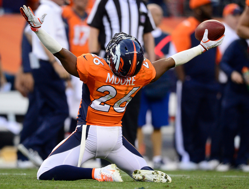 . Denver Broncos free safety Rahim Moore (26) celebrates after making an interception in the fourth quarter. The Denver Broncos take on the Washington Redskins at Sports Authority Field at Mile High in Denver on October 27, 2013. (Photo by AAron Ontiveroz/The Denver Post)