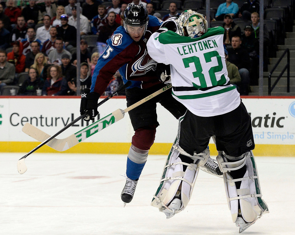 . Colorado Avalanche right wing P.A. Parenteau (15) collides with Dallas Stars goalie Kari Lehtonen (32) during the first period of action.  (Photo by AAron Ontiveroz/The Denver Post)