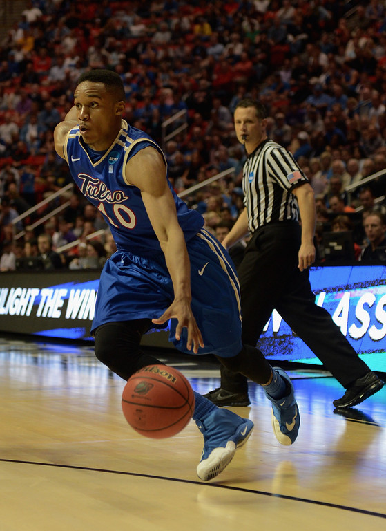 . James Woodard #10 of the Tulsa Golden Hurricane drives the ball against the UCLA Bruins during the second round of the 2014 NCAA Men\'s Basketball Tournament at Viejas Arena on March 21, 2014 in San Diego, California.  (Photo by Donald Miralle/Getty Images)