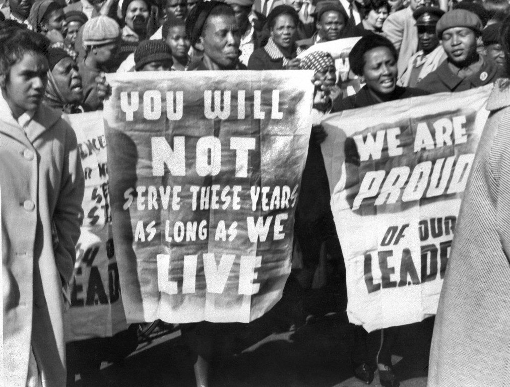 . African women demonstrate in front of the Law Courts in Pretoria, 16 June 1964, after the verdict of the Rivonia trial, in which eight men, among them anti-apartheid leader and African National Congress (ANC) member Nelson Mandela, were sentenced to life imprisonment. The eight men were accused of conspiracy, sabotage and treason. (OFF/AFP/Getty Images)
