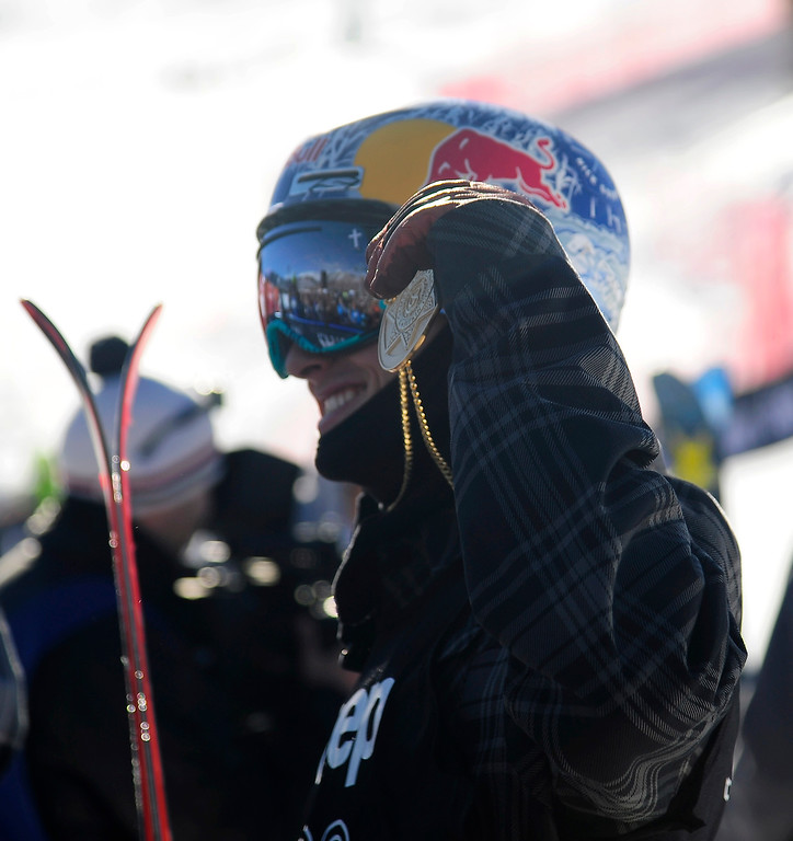 . Nick Goepper raises his medal after winning gold in the men\'s ski slopestyle final in Aspen at Winter X Games in Aspen, January 26, 2014. (Photo By Mahala Gaylord/The Denver Post)