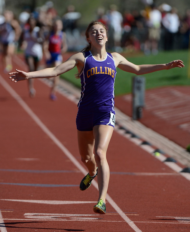 . LAKEWOOD, CO - MAY 16: Erin Hooker, Ft. Collins High School, celebrates crossing the finish line wo win the girls 5A 3200 meter run final at the 2013 Colorado State Track and Field Championships at Jeffco Stadium May 16, 2013. (Photo By Andy Cross/The Denver Post)
