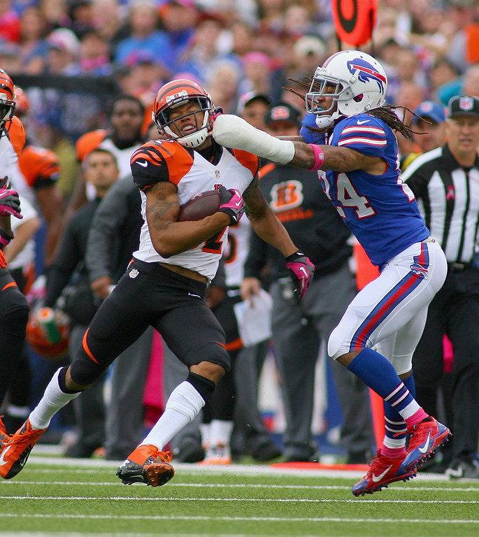 . Stephon Gilmore #24 of the Buffalo Bills tries to tackle  Marvin Jones #82 of the Cincinnati Bengals at Ralph Wilson Stadium on October 13, 2013 in Orchard Park, New York.  (Photo by Rick Stewart/Getty Images)