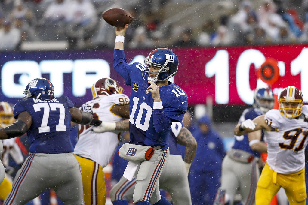 . Eli Manning #10 of the New York Giants passes against the Washington Redskins during their game at MetLife Stadium on December 29, 2013 in East Rutherford, New Jersey.  (Photo by Jeff Zelevansky/Getty Images)