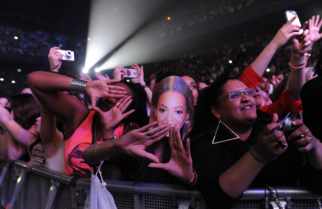 """. Fans in the audience at Beyonce\'s \""""Mrs. Carter Show World Tour 2013\"""", on Monday, April 22, 2013 at the Ziggo Dome in Amsterdam, Netherlands. (Photo by Frank Micelotta/Invision for Parkwood Entertainment/AP Images."""