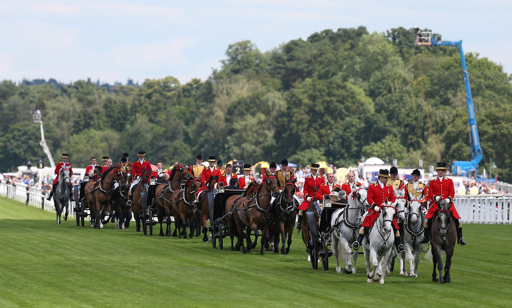. The Royal procession proceeds along the racecourse on day two of Royal Ascot at Ascot Racecourse on June 18, 2014 in Ascot, England. (Photo by Steve Bardens/Getty Images)