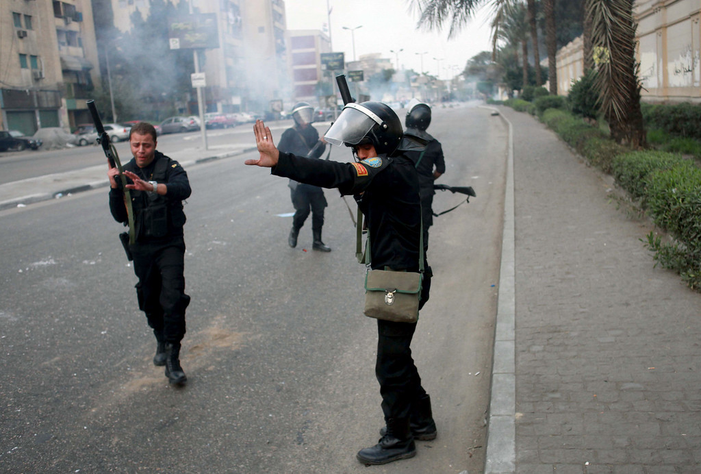. Egyptian riot police fire tear gas in Cairo, Egypt, Friday, Nov. 29, 2013, to disperse hundreds of Islamist demonstrators outside of Qobba Palace defying a new protest law that has drawn widespread criticism from the international community and democracy advocates.(AP Photo/Sabry Khaled, El Shorouk Newspaper)