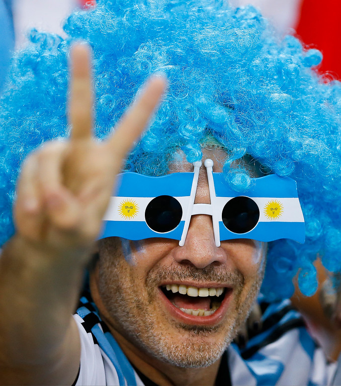 . An Argentine fan gives the victory sign before the group F World Cup soccer match between Argentina and Bosnia at the Maracana Stadium in Rio de Janeiro, Brazil, Sunday, June 15, 2014.  (AP Photo/Kirsty Wigglesworth)