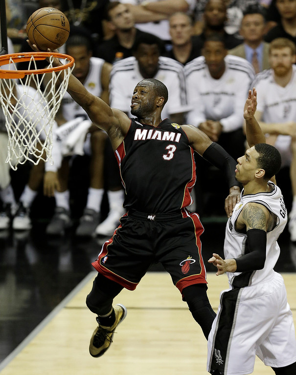 . Miami Heat\'s Dwyane Wade (3) gets around San Antonio Spurs\' Danny Green (4) to score during the second half at Game 5 of the NBA Finals basketball series, Sunday, June 16, 2013, in San Antonio. (AP Photo/David J. Phillip)
