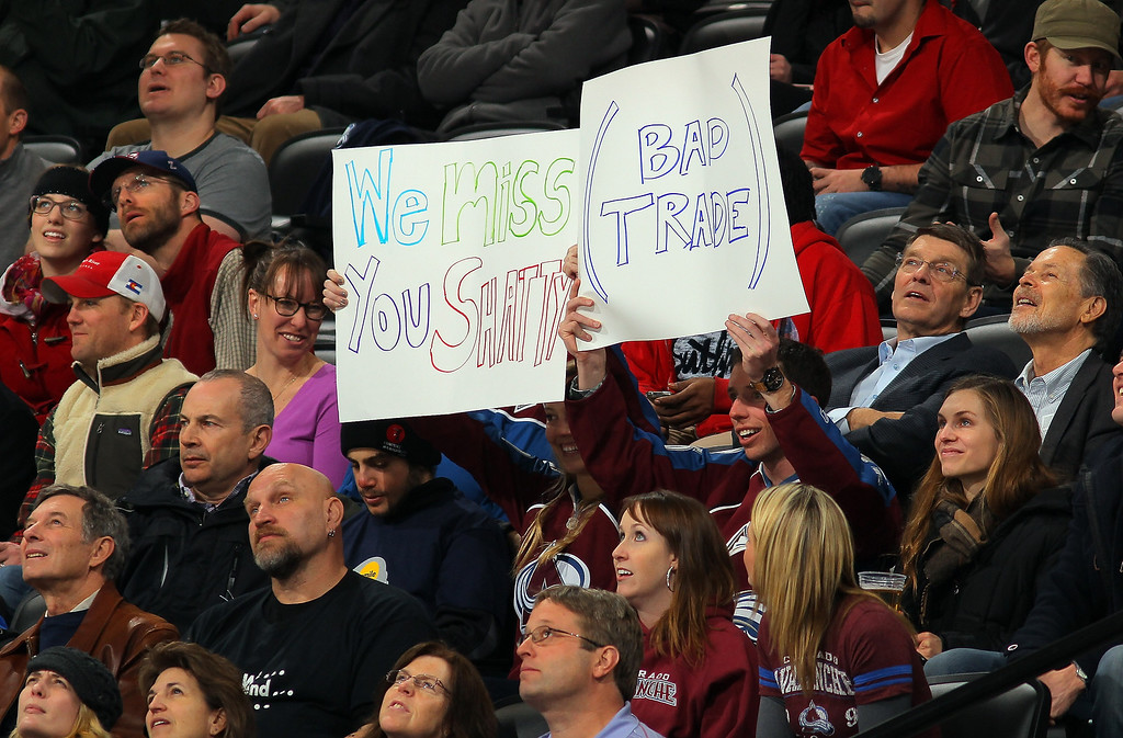 . Fans display a sign referencing the trade of Kevin Shattenkirk #22 of the St. Louis Blues from the Colorado Avalanche at the Pepsi Center on February 20, 2013 in Denver, Colorado.  (Photo by Doug Pensinger/Getty Images)