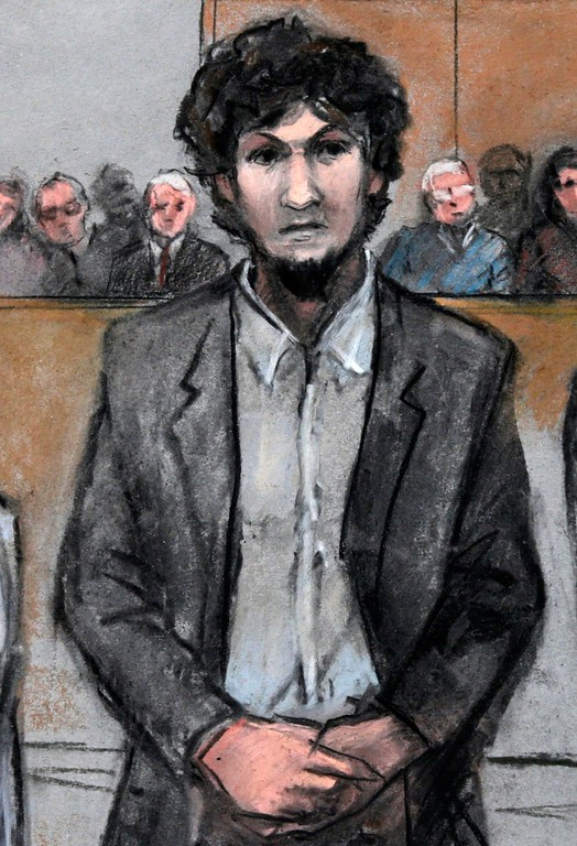 . In this courtroom sketch, Boston Marathon bomber Dzhokhar Tsarnaev stands as a death by lethal injection sentence is read at the Moakley Federal court house in the penalty phase of his trial in Boston, Friday, May 15, 2015. The federal jury ruled that the 21-year-old Tsarnaev should be sentenced to death for his role in the deadly 2013 attack. (Jane Flavell Collins via AP)