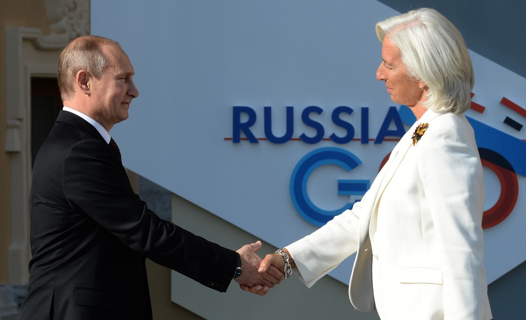 . Russias President Vladimir Putin (L) welcomes International Monetary Fund (IMF) Managing Director Christine Lagarde (R) at the start of the G20 summit on September 5, 2013 in Saint Petersburg.    AFP PHOTO / YURI  KADOBNOV/AFP/Getty Images