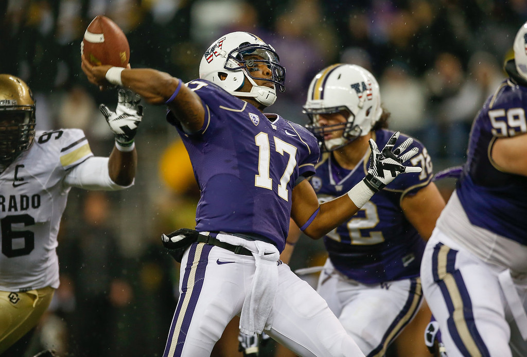 . Quarterback Keith Price #17 of the Washington Huskies passes against the Colorado Buffaloes on November 9, 2013 at Husky Stadium in Seattle, Washington.  (Photo by Otto Greule Jr/Getty Images)