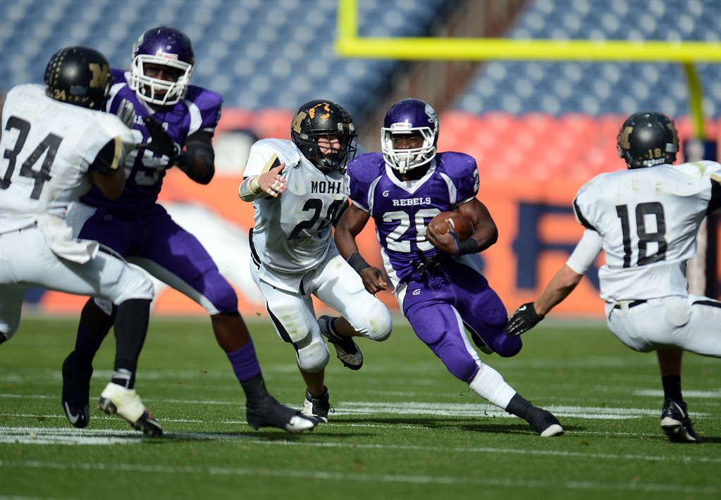 . Denver South RB Pete Williams(28) is rushing against against Monarch defense in the 1st half of 4A State Championship game at Sports Authority Field at Mile High on Saturday, Dec. 1, 2012. Hyoung Chang, The Denver Post