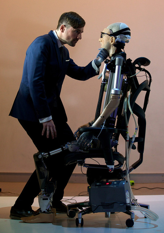 """. Researcher Bertolt Meyer, a lifelong user of prosthetic technology and the model for \""""Rex\"""", the world\'s first \""""bionic man\"""", poses with the humanoid during a photo call at the Science Museum in London on February 5, 2013. The 640,000 GBP (1 million US dollars) bionic has a distinctly human shape and boasts prosthetic limbs, a functional artificial blood circulatory system complete with artificial blood, as well as an artificial pancreas, kidney, spleen and trachea. Rex will be displayed at the Science Museum from February 7.  ANDREW COWIE/AFP/Getty Images"""
