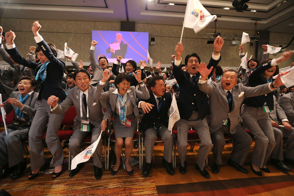 . Members of the Tokyo 2020 delegation celebrate after Tokyo was awarded the 2020 Olympic Games during the 125th IOC session in Buenos Aires, Argentina,  Saturday, Sept. 7, 2013. Tokyo defeated Istanbul in the final round of secret voting Saturday by the International Olympic Committee. Madrid was eliminated earlier after an initial tie with Istanbul. (AP Photo/Ian Watson, Pool, File)