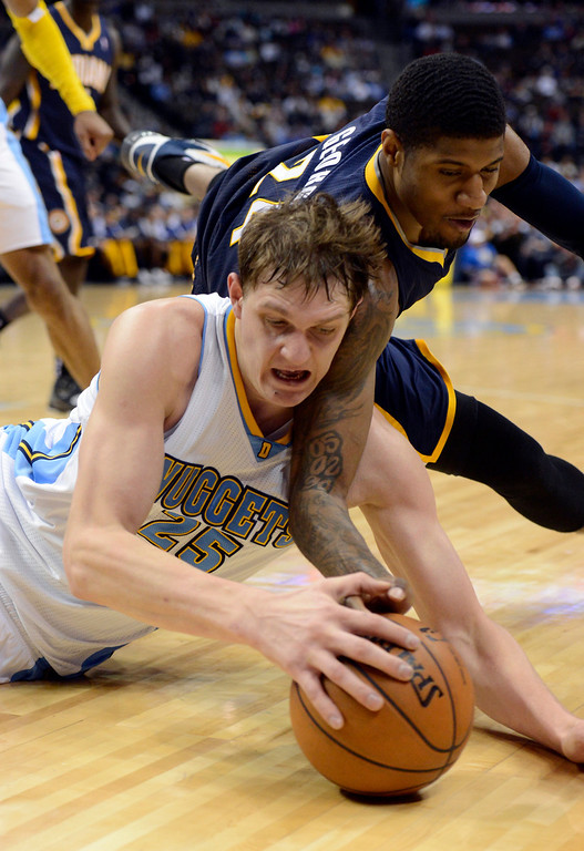 . DENVER, CO. - JANUARY 28: Denver Nuggets center Timofey Mozgov (25) dives after a loose ball with Indiana Pacers small forward Paul George (24) during the fourth quarter January 28, 2013 at Pepsi Center. The Denver Nuggets defeated the Indiana Pacers 102-101 in NBA Action. (Photo By John Leyba / The Denver Post)