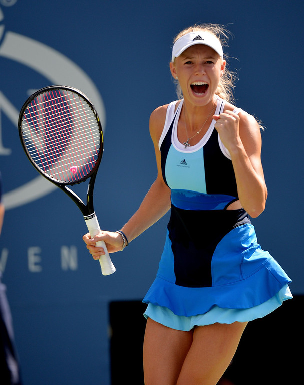 . Caroline Wozniacki of Denmark celebrates a win over Ying-Ying Duan of China during their 2013 US Open women\'s singles match at the USTA Billie Jean King National Tennis Center August 27, 2013 in New York. Wozniacki won, 6-2, 7-5. STAN HONDA/AFP/Getty Images